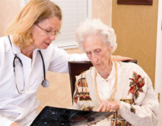 An elder care professional assists a senior